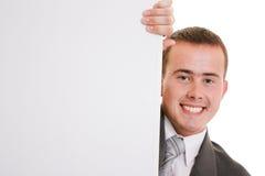 Uomo d'affari che tiene una scheda bianca. Immagine Stock Libera da Diritti