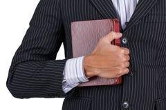 Uomo d'affari che tiene vecchio libro Fotografie Stock Libere da Diritti