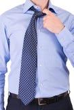 Uomo d'affari che tira il suo collare. Immagini Stock