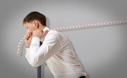 Uomo d'affari che tira una corda Fotografie Stock Libere da Diritti