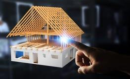 Uomo d'affari che tocca 3D che rende la casa non finita di piano con il suo Fotografie Stock Libere da Diritti