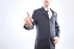 Uomo d'affari che tocca lo schermo Fotografia Stock Libera da Diritti