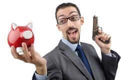 Uomo d'affari che uccide banca piggy Fotografie Stock Libere da Diritti