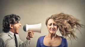 Uomo d'affari che urla con un megafono Immagini Stock