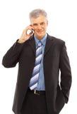 Uomo d'affari che usando un lphone Immagini Stock Libere da Diritti