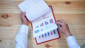 Uomo d'affari Checks Investment Charts stock footage