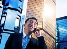 Uomo d'affari China Hong Kong Talking Phone Concept immagine stock libera da diritti