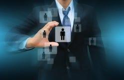 Uomo d'affari Choosing la persona giusta Fotografia Stock Libera da Diritti