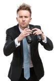 Uomo d'affari con binoculare fotografia stock
