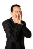 Uomo d'affari con gli entrambi metà della copertura della palma del suo fa fotografia stock libera da diritti