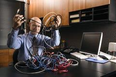 Uomo d'affari con i cavi Fotografia Stock