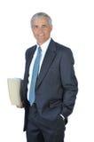 Uomo d'affari con i dispositivi di piegatura di archivio Fotografia Stock