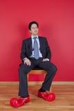 Uomo d'affari con i pattini del pagliaccio Fotografie Stock