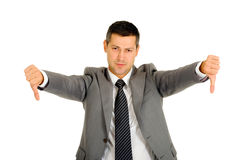 Uomo d'affari con i pollici giù Immagini Stock