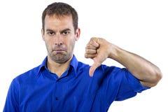 Uomo d'affari con i pollici giù Immagini Stock Libere da Diritti