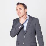 Uomo d'affari con i problemi di voce Fotografia Stock Libera da Diritti