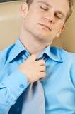 Uomo d'affari con i problemi sanitari Fotografie Stock Libere da Diritti