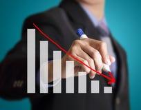 Uomo d'affari con i simboli finanziari Immagine Stock