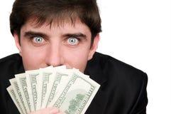 Uomo d'affari con i soldi dei dollari Immagine Stock