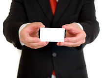 Uomo d'affari con il biglietto da visita in bianco Fotografia Stock