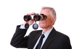 Uomo d'affari con il binocolo Fotografia Stock