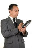 Uomo d'affari con il calcolatore del ridurre in pani Fotografie Stock Libere da Diritti
