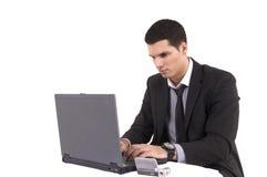Uomo d'affari con il calcolatore superiore ed il telefono di giro Fotografie Stock Libere da Diritti