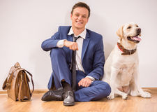 Uomo d'affari con il cane Fotografia Stock
