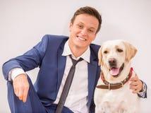 Uomo d'affari con il cane Fotografie Stock Libere da Diritti