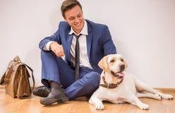 Uomo d'affari con il cane Fotografia Stock Libera da Diritti