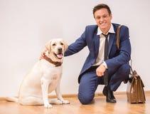 Uomo d'affari con il cane Fotografie Stock
