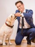 Uomo d'affari con il cane Immagine Stock Libera da Diritti