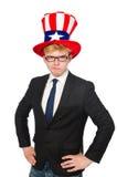 Uomo d'affari con il cappello americano isolato su bianco Fotografie Stock Libere da Diritti