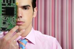 Uomo d'affari con il circuito elettronico in fronte Immagine Stock