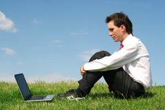 Uomo d'affari con il computer portatile Immagine Stock Libera da Diritti