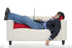Uomo d'affari con il computer portatile Immagine Stock