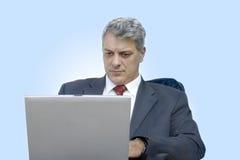 Uomo d'affari con il computer portatile Immagini Stock Libere da Diritti