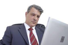 Uomo d'affari con il computer portatile fotografie stock