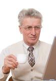 Uomo d'affari con il computer portatile su bianco Immagini Stock Libere da Diritti