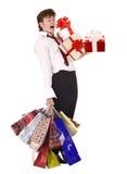 Uomo d'affari con il contenitore di regalo del gruppo ed il sacchetto di acquisto. Fotografie Stock Libere da Diritti