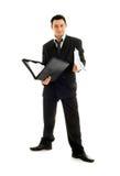 Uomo d'affari con il dispositivo di piegatura Fotografia Stock Libera da Diritti