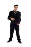 Uomo d'affari con il dispositivo di piegatura nero Fotografia Stock