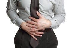 Uomo d'affari con il dolore di stomaco Fotografie Stock