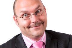 Uomo d'affari con il fronte divertente Fotografia Stock Libera da Diritti