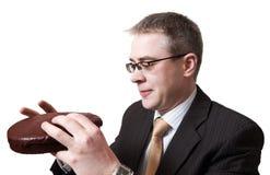 Uomo d'affari con il grafico a torta del cioccolato Immagini Stock