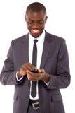 Uomo d'affari con il mobile immagini stock libere da diritti