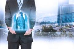 Uomo d'affari con il modello della città 3d Immagini Stock Libere da Diritti