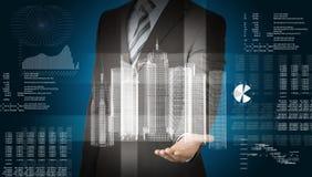 Uomo d'affari con il modello ed i grafici della città 3d Immagine Stock Libera da Diritti