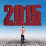 Uomo d'affari con il numero 2015 Fotografia Stock Libera da Diritti