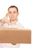 Uomo d'affari con il pacchetto Fotografia Stock